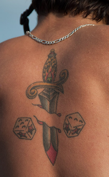 #1859: a large tattoo on a person's back.